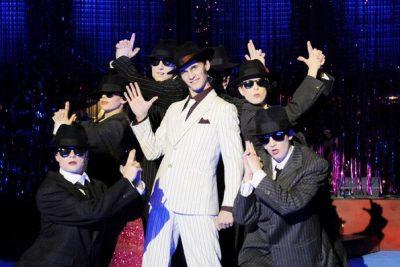 Sugar, Manche mögens heiß, Musical - Benjamin Geipel als Spatz Palazzo